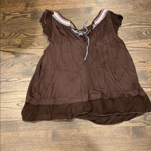 Brown flowing top with ruffles and open neck